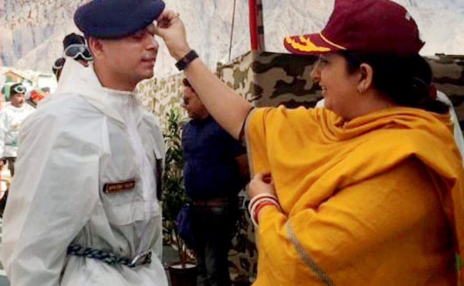 "Textiles Minister Smriti Zubin Irani puts a tilak on a soldier as she celebrates ""Raksha Bhandan"" with Army jawans at Siachen Glacier on Thursday. PTI Photo / Twitter (PTI8_18_2016_000207B)"