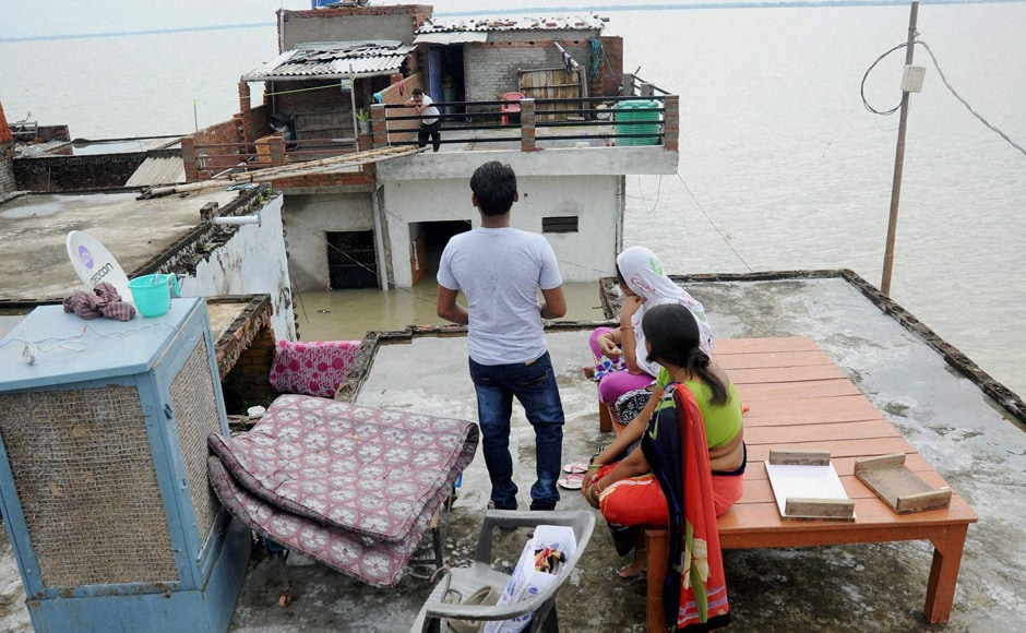 """Another low-lying area on the banks of Ganga, Salori was also inundated with flood water as people took shelter on the roof of their houses. People have been asked to move to safer places"""" a district official informed, while adding that NDRF and PAC personnel have been deployed for rescue operations at some places. PTI"""