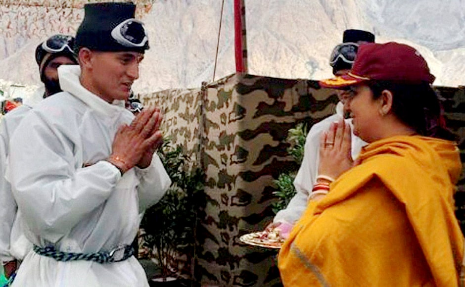 "Textiles Minister Smriti Zubin Irani interacts with a soldier as she celebrates ""Raksha Bhandan"" with Army jawans at Siachen Glacier on Thursday. PTI Photo / Twitter (PTI8_18_2016_000256B)"