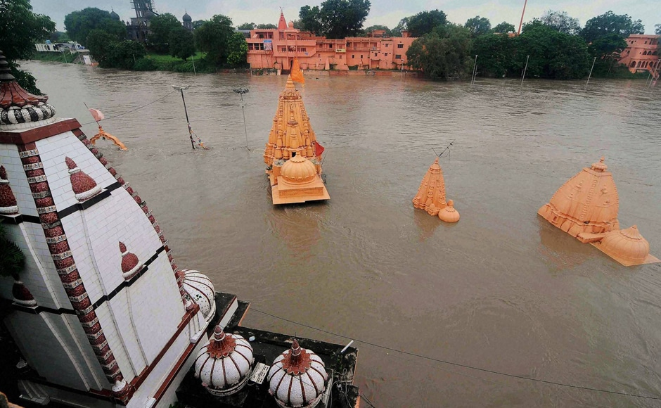 Torrential rains continue to lash Madhya Pradesh even as relief work has gained momentum. Normal life has been affected in Ujjain and other western parts of the state. Temples are also submerged at Ram ghat due to heavy rains which caused floods in Kshipra river in Ujjain. Photo: PTI