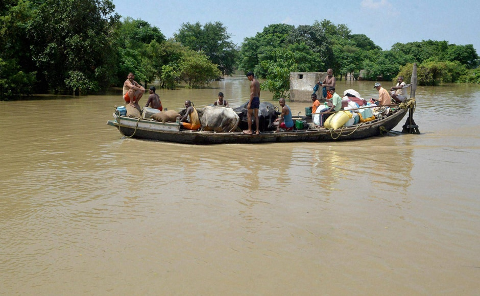 "Normal lives remained disrupted in Patna after floodwater entered new areas. Bihar Chief Minister Nitish Kumar has appealed to the people to ""move to safer places. People are shifting with their cattle to safer places in flood affected Nakta Diyara, Patna. Photo: PTI"