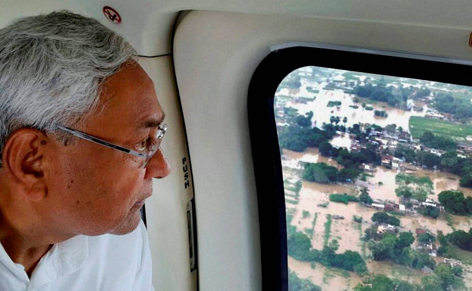 Kumar did an aerial survey of affected areas and demanded that experts look into the problem of silt in rivers. Photo: PTI