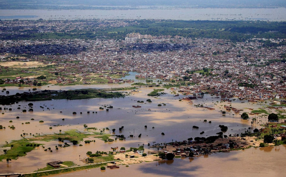 Water entered residential areas in Allahabad after river Ganga flowed above danger level. About 12,000 people were evacuated from low-lying surrounding villages. An aerial view of flood affected areas of Allahabad. Photo: PTI