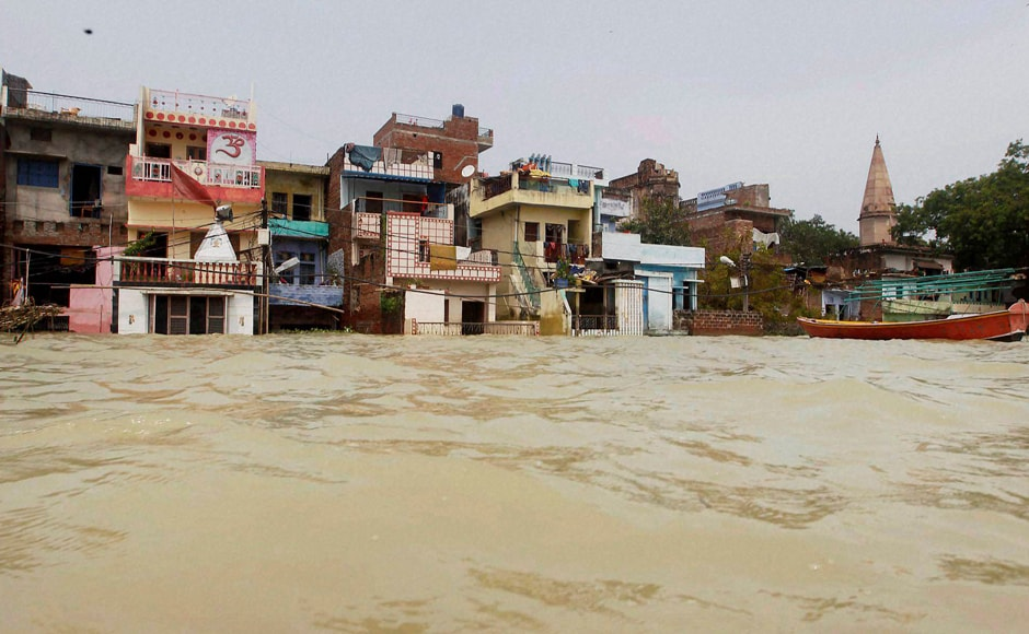 Many houses in Allahabad where water had entered due to the floods have been turned into swamps with mud inside their homes. PTI