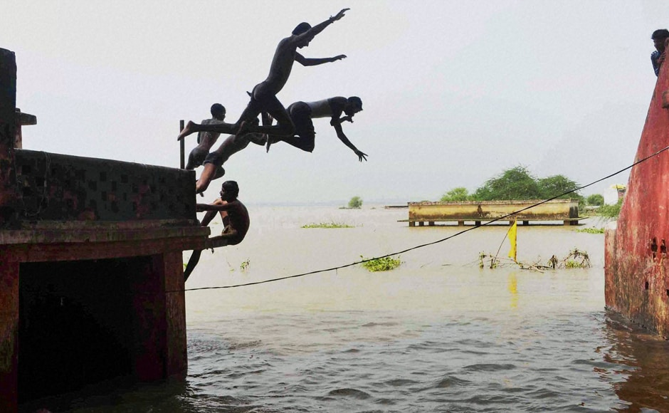 Boys jump in flood water at Daraganj area in Allahabad while in the last 24-hours, the river Ganga receded by about 40 cm while Yamuna's water levels decreased by about 30 cm.