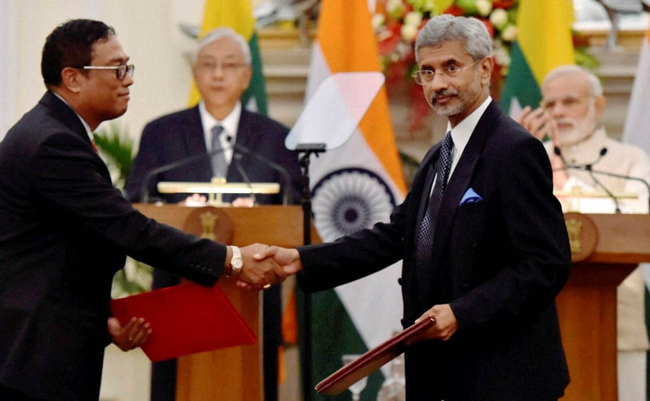 India's Foreign Secretary S Jaishankar (Left) exchanges documents after signing an agreement with Myanmar government official at Hyderabad house in presence of the two leaders.  PTI