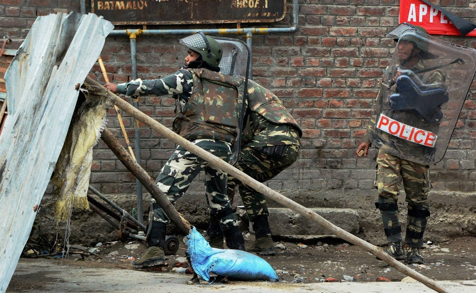Security forces in action against protesters during a clash in Srinagar. Curfew was clamped in the Valley on 9 July following violence in the aftermath of Wani's killing in an encounter in south Kashmir's Anantnag district on 8 July. PTI