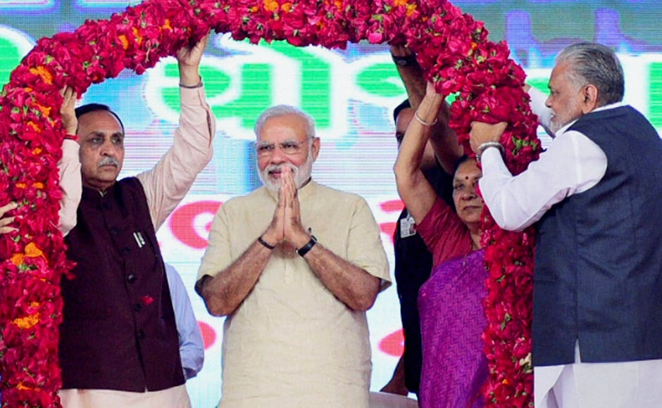 Modi, Gujarat CM Vijay Rupani and former CM Anandiben Patel being garlanded during the inaugural function of the first phase of SAUNI project. Modi also addressed a rally in Jamnagar after launching SAUNI. PTI