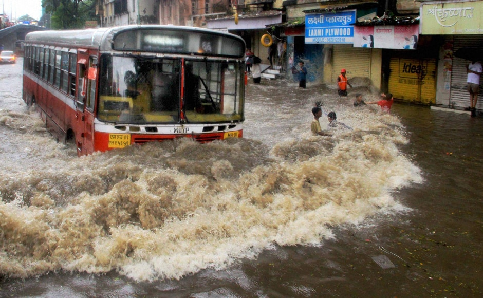 On Friday morning, heavy rains flooded many parts of Mumbai, disrupting rail and road traffic, as well as flights. Buses were seen wading through flooded streets. PTI