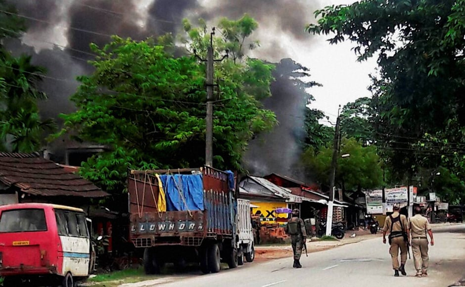 Smoke coming out of shops after an attack by NDFB (S) terrorists in the market area at Balajan Tinali near Kokrajhar town in Assam on Friday where 14 people were killed. PTI