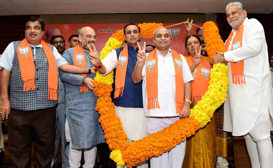 Nitin Patel, Deputy Chief Minister (on the right) name gained more circulation. But in the end, it was Rupani with his non-controversial, low-profile and sincere organisational man credentials which prevailed. PTI