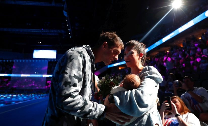Michael Phelps with longtime partner Nicole Johnson and son Boomer Phelps. Getty