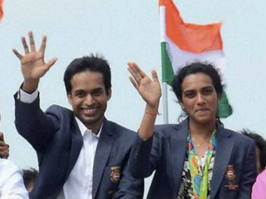 PV Sindhu and her coach Pullela Gopichand during their recent open-top parade in Hyderabad, which preceded their visit to Vijaywada. PTI