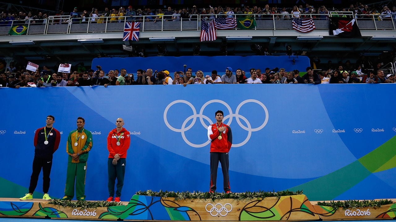Joint silver medalists, Michael Phelps of United States, Chad Guy Bertrand le Clos of South Africa, Laszlo Cseh of Hungary and gold medalist Joseph Schooling of Singapore celebrate on the podium during the medals ceremony in the Men's 100m Butterfly Final of Rio Olympics. Getty Images