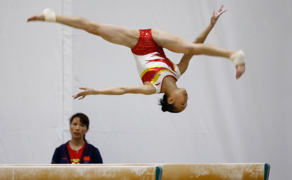 Chinese gymnasts practice on the beam. China have sent in 416 athletes to Rio de Janeiro, its largest overseas delegation in Olympic history, continuing in its pursuit of medals. AP