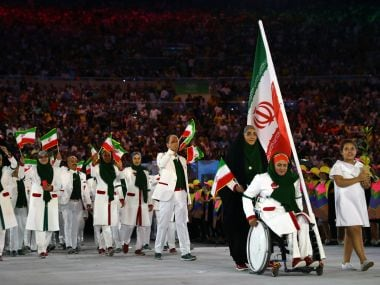 Zahra Nemati of Iran leads her country's contingent into the stadium. Reuters
