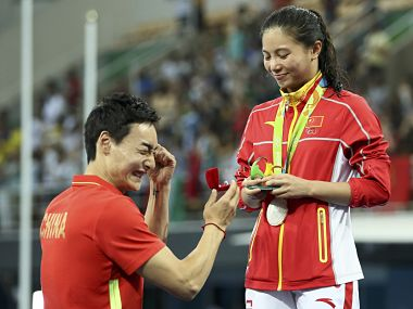 He Zi of China recieves a marriage proposal from Qin Kai of China after the medal ceremony. She accepted Qin's proposal. Reuters