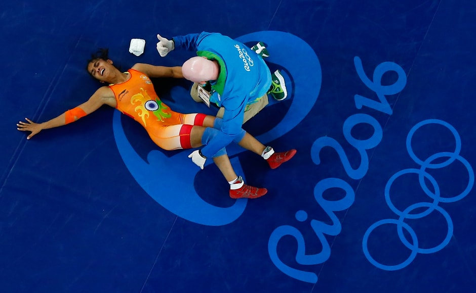 India's Vinesh Phogat was forced out of the 48kg competition due to an unfortunate knee injury suffered during her Women's Freestyle 48 kg quarterfinal bout against Chinese rival Sun Yanan. Reuters
