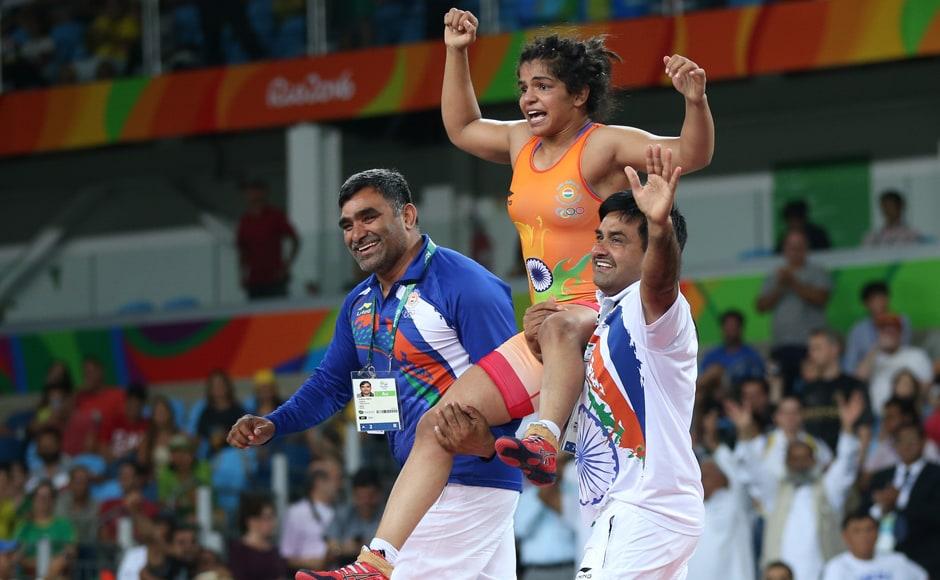 Sakshi Malik of India celebrates with her team members after winning the bronze medal. Reuters