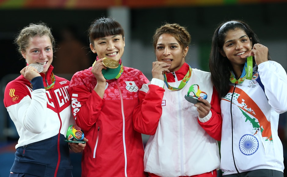 Valeriia Koblova of Russia, Kaori Icho of Japan, Maroua Amri of Tunisia and Sakshi Malik of India pose with their medals. Reuters