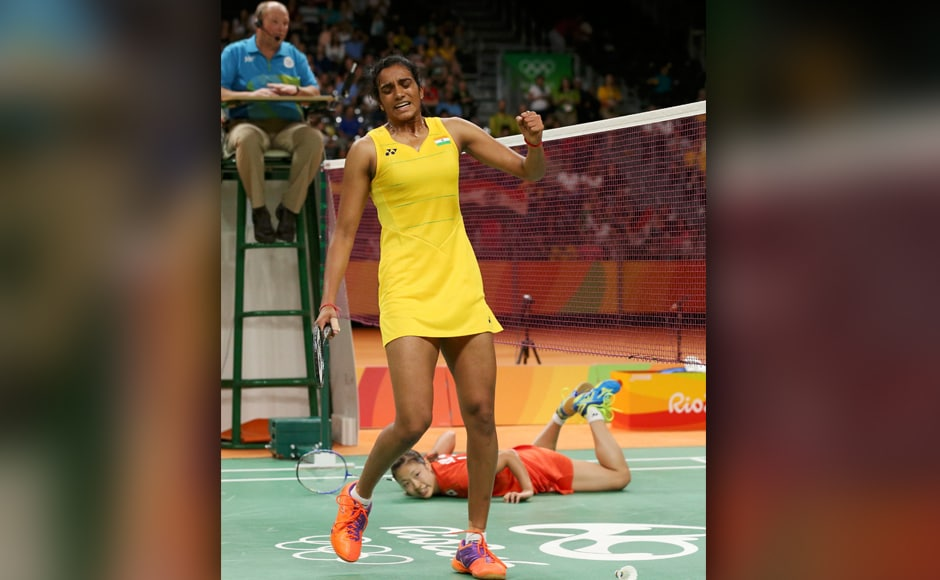 PV Sindhu of India celebrates a point as Nozomi Okuhara of Japan lies on the court after falling during play. Reuters