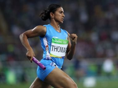Anilda Thomas competes in a women's 4x400-meter relay heat. AP