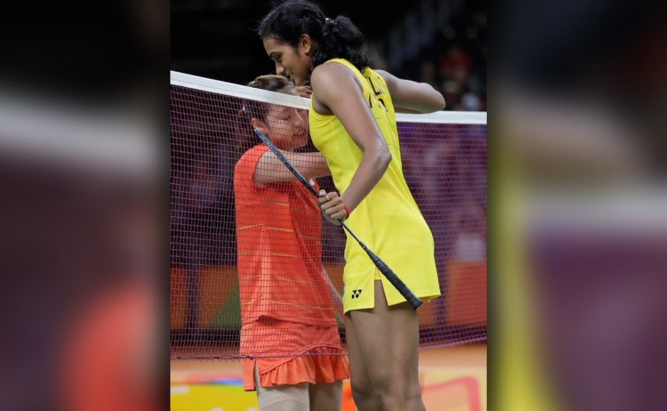 India's PV Sindhu shakes hands with Japan's Nozomi Okuhara over the net after winning. AP