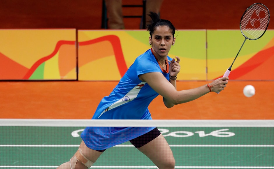 One of India's biggest medal hopes Saina Nehwal staved off a spirited challenge from Brazilian Vicente Lohaynny 21-17 21-17 in a women's singles badminton match which lasted 39 minutes. AP