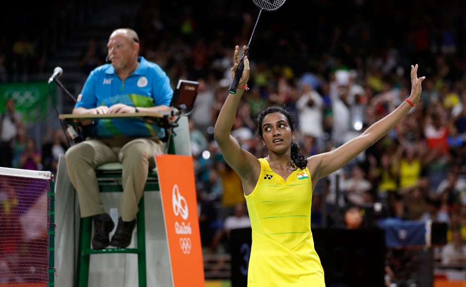 India's PV Sindhu waves after winning women's singles semifinal badminton match against Japan's Nozomi Okuhara. She will next take on two-time World Champion and top seed Carolina Marin of Spain in the final on Friday.AP