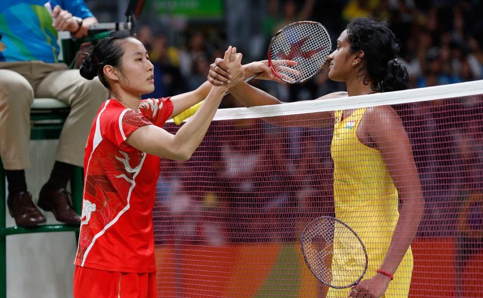 India's PV Sindhu greeted by China's Wang Yihan after winning the Women's Singles Quarterfinal. AP