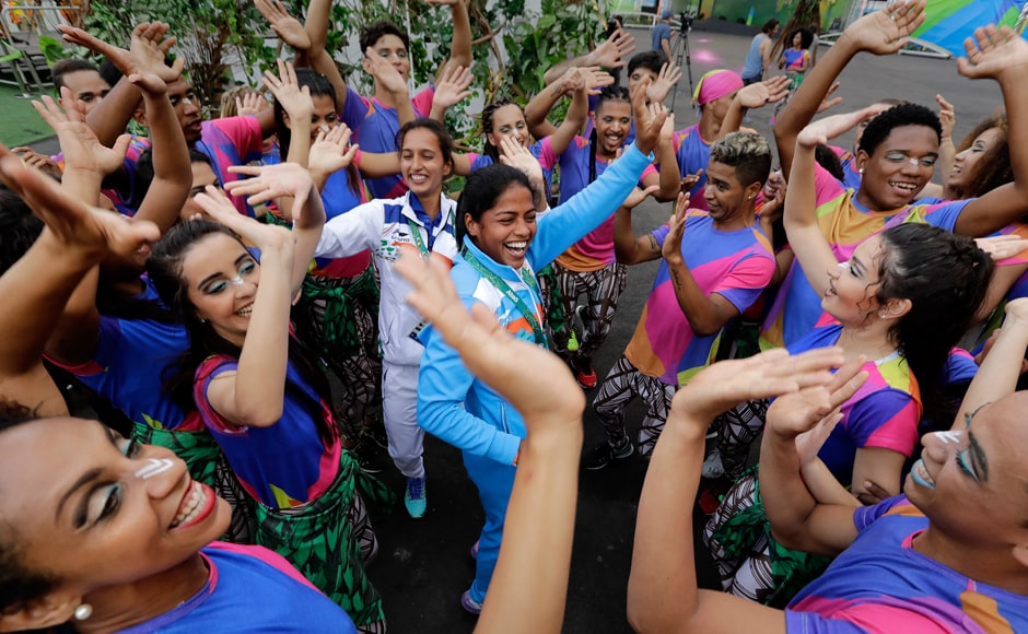 India's women's hockey team players Deepika Deepika and Preety Dubey dance following a welcome performance at the Olympic athletes' village. AP