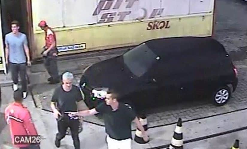 In this14 August frame from surveillance video released byBrazil Police, swimmerRyan Lochte and teammates, appear at a gasstation. AP