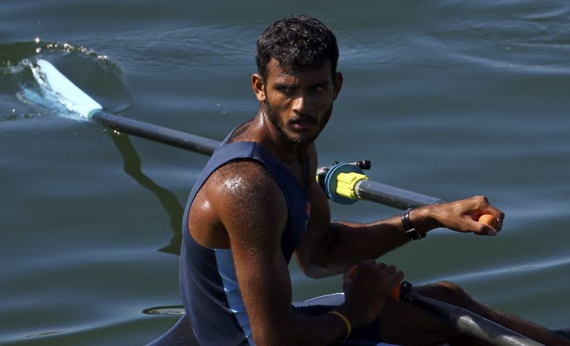 Dattu Baban Bhokanal looks over his shoulder after competing in the men's rowing single sculls event. AP