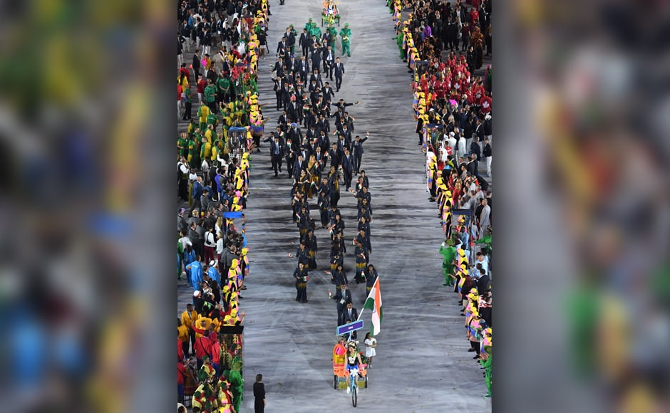 Abhinav Bindra leads the way with the tricolour, as the rest of the Indian contingent follows suit at the opening ceremony. AP