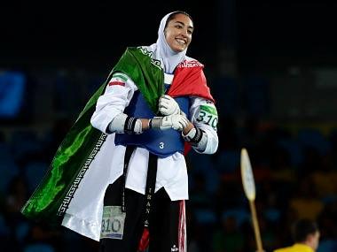 Kimia Alizadeh Zenoorin, of Iran celebrates after winning a bronze medal in women's 57-kg taekwondo competition. AP