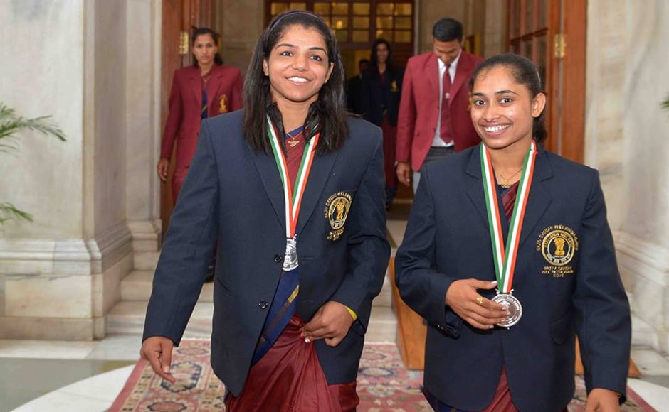Sakshi Malik and Dipa Karmakar walk out after the award ceremony ended. Image: PIB_India Twitter