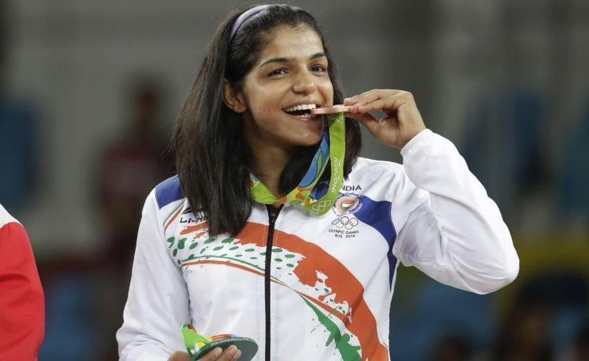 Sakshi Malik poses with her bronze medal. AP