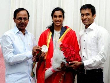 Telangana Chief Minister K Chandrasekhar Rao felicitates Olympic silver medalist shuttler PV Sindhu and coach Pullela Gopichand. PTI