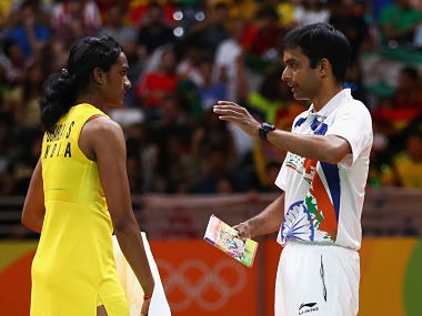 PV Sindhu talks to Pullela Gopichand during the Women's Singles Gold Medal Match. Getty