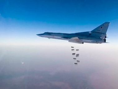 In this frame grab from video provided by the Russian Defence Ministry Press Service, Russian long range bomber Tu-22M3 flies during a strike above an undisclosed location in Syria on Sunday, Aug. 14, 2015. ( Russian Defence Ministry press service photo via AP)