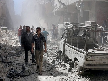 FILE - In this Tuesday, July. 26, 2016 file photo, provided by the Syrian anti-government activist group Aleppo Media Center (AMC), shows Syrian citizens inspect damaged buildings after airstrikes hit Aleppo, Syria. Fierce fighting and airstrikes continue in Syria's northern city of Aleppo as insurgents try to break a siege on opposition-held eastern districts in a counteroffensive to government advances. But Syria's war, now in its sixth year, is raging beyond Aleppo, claiming dozens of lives every day. (Aleppo Media Center via AP, File)