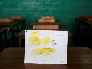 """A drawing made during a lesson at a school shows what a student ate during the course of a day in Caracas, Venezuela. The student wrote, """"Today I ate nothing for breakfast and had pasta with Mortadella for lunch. I'm hungry."""" Reuters"""