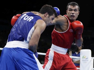 Vikas Krishan fights Onder Sipal during men's middleweight 75-kg preliminary boxing match. AP