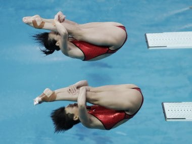 China's Shi Tingmao and Wu Minxia (top) during the women's synchronized 3-meter springboard diving. AP