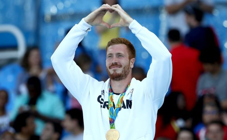 Discus throw gold medalist Christoph Harting poses on the podium during the medal ceremony. Getty Images