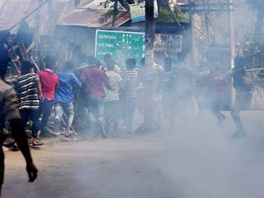 Srinagar: Police in action against the protesters who defied curfew and tried to march to Hazratbal Shrine at Nati Pora in Srinagar on Friday. PTI