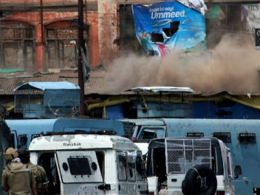 Smoke rises from a complex where militants and police personnel clashed in Kashmir. PTI