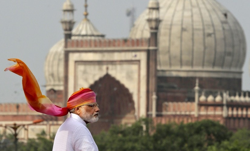 Indian Prime Minister Narendra Modi addresses the nation from the ramparts of the historical Red Fort on the Independence Day in New Delhi, India, Monday, Aug. 15, 2016. India commemorated its Independence in 1947 from British colonial rule, on Aug. 15. In the back ground India's biggest Jama Maszid or Mosque is seen. (AP Photo/Manish Swarup)