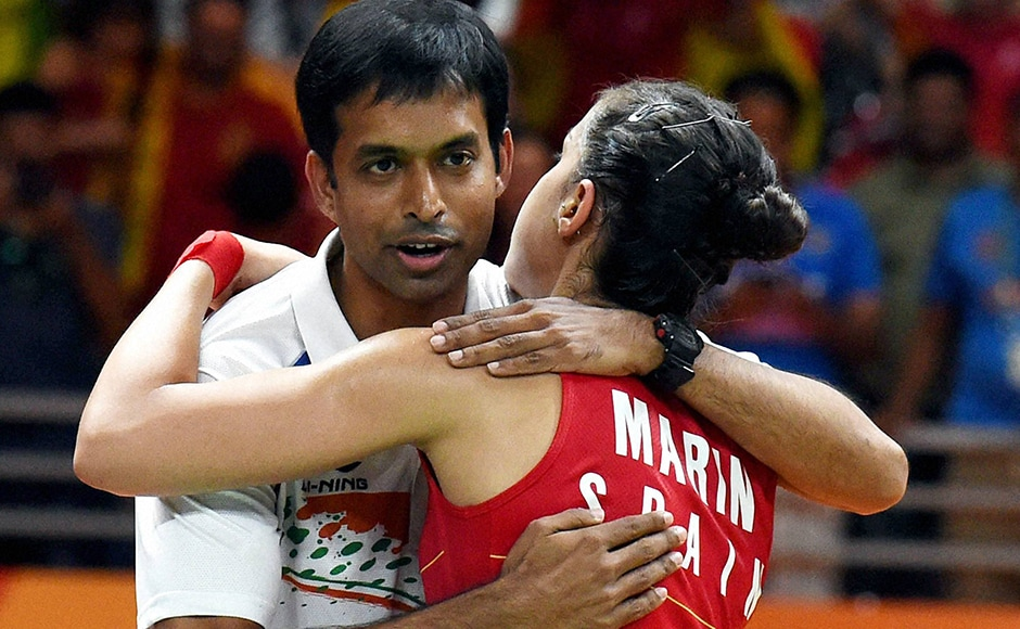 Spain's Carolina Marin with Indian coach Pullela Gopichand after defeating India's PV Sindhu in the women's badminton singles gold medal match at the 2016 Summer Olympics. PTI