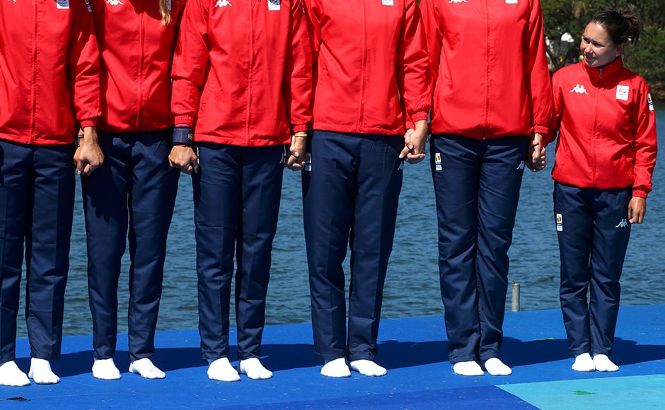 Romania's Coxswain Daniela Druncea looks over her team which won the bronze medal at the women's eight rowing event. Reuters